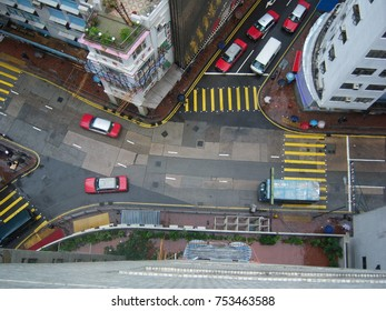 A Day Time Aerial Top-View of a Hong Kong City Block at Rush Hour