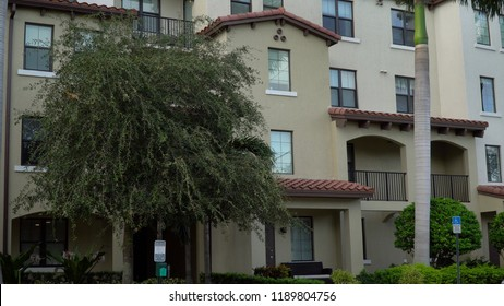 Day time exterior establishing shot of generic apartment or condominium building facade on street level. Southwest USA architecture style in southern location