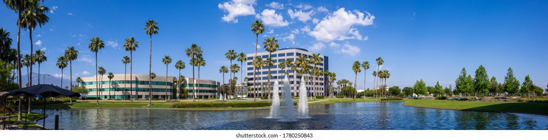 Day time panoramic ground level view of the modern Ontario, California skyline.
