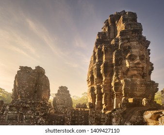 Day view of ancient temple Bayon Angkor complex with stone faces of buddha Siem Reap, Cambodia
