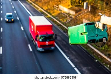 Day view of average speed traffic camera over UK Motorway.