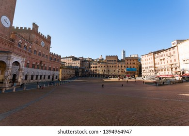 Day view of Campo Square (Piazza del Campo), Siena Palazzo Pubblico and Mangia Tower (Torre del Mangia) in Siena, Tuscany, Italy.