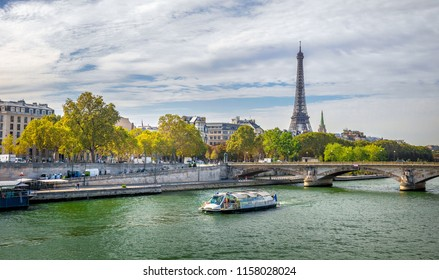 Day view of Eiffel tower, Pont des Arts and Seine river in Paris, France. Architecture and landmarks of Paris. Postcard of Paris