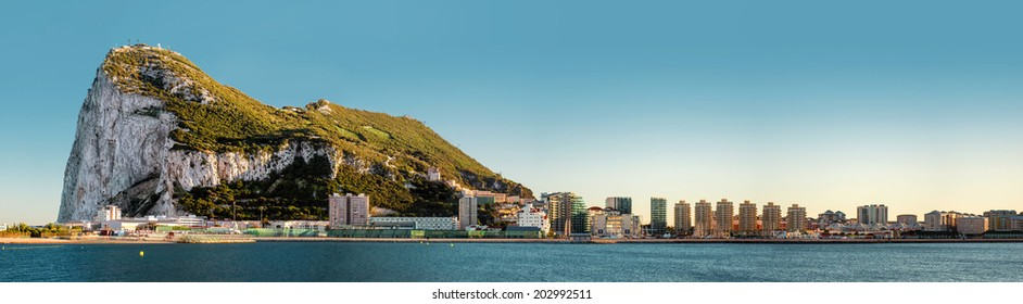 Day view of Gibraltar. Gibraltar is a British Overseas Territory located on the southern end of the Iberian Peninsula at the entrance of the Mediterranean Sea