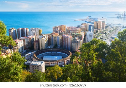Day view of Malaga with Port and Placa de Torros from castle in sunny time.  Andalusia, Spain
