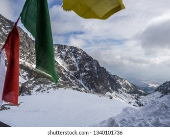 The day view of Small Cold Valley (Mala Studená Dolina) and prayer flags  captured from Teryho Hut (Téryho Chata) in cold snowy winter time. High Tatras, Slovakia.