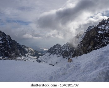 The day view of Small Cold Valley (Mala Studená Dolina) captured from Teryho Hut (Téryho Chata) in cold snowy winter time. High Tatras, Slovakia.