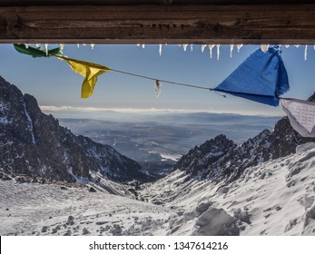 The day view of Small Cold Valley (Mala Studená Dolina) and prayer flags in cold snowy winter time. High Tatras, Slovakia.