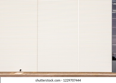 day view white metal steel texture surface of cargo warehouse wall in industrial estate in england