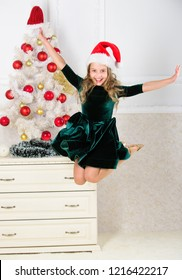Day we have waited for all year finally here. Girl excited about christmas jump mid air. Child emotional cant stop her feelings. Celebrate christmas concept. Girl in dress jumping. It is christmas.