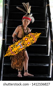 A Dayak boy is demonstrating a dayak dance on the stairs at the East Kalimantan bridge, Taman Mini Indonesia Indah, Jakarta, on November 15, 2014.