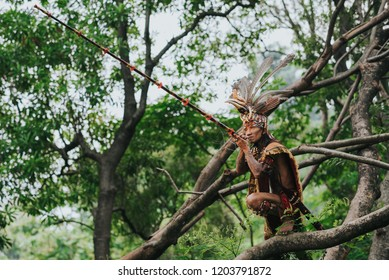 A Dayaknese man hunt a bird.  These picture was taken in Jakarta in a conceptual photography of Dayak Tribes.  Took this picture at Jakarta City Forest in April 30, 2016.