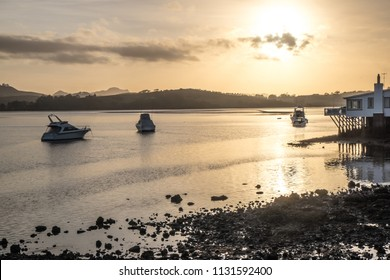 Daybreak - dawn with boats and rocks at Mangonui Harbour, Far North District, Northland, New Zealand NZ
