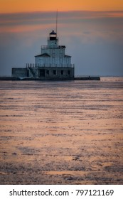 Daybreak on the Lake Michigan ice and lighthouse in Manitowoc, Wisconsin.