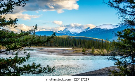 Daybreak over the Athabasca River near the town of Jasper in Jasper National Park in the Canadian Rocky Mountains