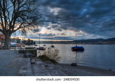 Daybreak over Lake Zurich in Autumn with the snow capped Alps in the distance