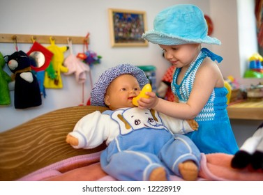Daycare - baby girl plays with a toy