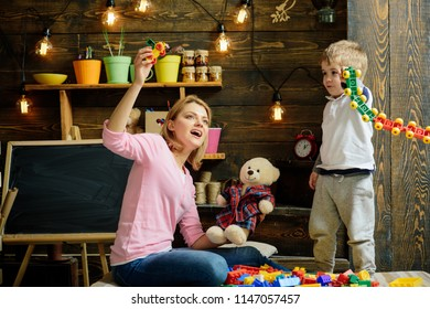 Daycare concept. Little child play daycare game with woman. Daycare preschool. Family daycare. Fun place to play and learn.