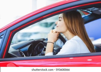Daydreaming. Beautiful young woman sitting in a car looking away dreamily copyspace traveling opportunities new beginnings lifestyle dreams dreaming wishing happiness lifestyle driver feminine concept