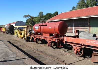 DAYLESFORD, AUSTRALIA - March 31, 2018: Machinery and rolling stock stored at the Daylesford tourist railway station