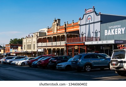 DAYLESFORD, VICTORIA, AUSTRALIA - 16 MARCH 2019: Busy Vincent Street in the popular tourist destination of Daylesford with its quaint colonial and gold rush era buildings and facades.