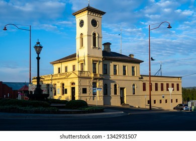 DAYLESFORD, VICTORIA, AUSTRALIA - 17 MARCH 2019: Historic Daylesford Post Office with its prominent clock tower highlighted against a cloudy blue sky.