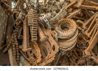 Daylesford,Victoria-Australia-4/22/2019: Collection of rusty metallic items (chains, bolts, cluch plates etc.)