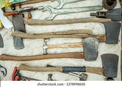 Daylesford,Victoria-Australia-4/22/2019: Collection of vintage tools and axes on a tarp shot from above