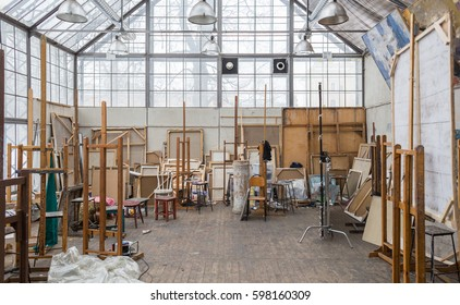 Daylight Art Studio Interior with Large Windows, Multiple Stretched Canvases and Stuff, Saint-Petersburg, Russia, 17 february, 2017