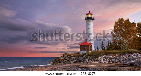 As daylight begins yielding to twilight, The Crisp Point Lighthouse at sunset on Lake Superior, Upper Peninsula, Michigan, USA - A one hour drive from Tahquamenon Falls, mostly dirt roads