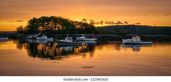 Daylight dawns on Cundys Harbor in Harpswell, Maine. Beautiful light illuminates the fishing boats of this peaceful cove.