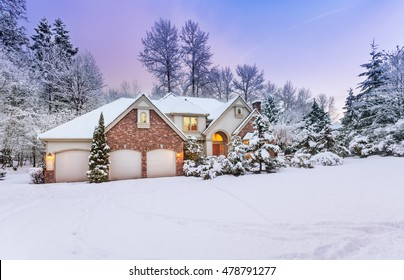 Daylight fades over a snow-covered suburban home