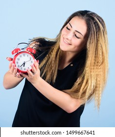 Daylight saving time. Change time zone. Watch repair. Time management. Punctuality and discipline. Pretty girl managing her time. Woman hold vintage alarm clock. Practice of advancing clocks.