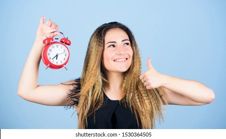 Daylight saving time. Change time zone. Pretty girl managing her time. Time management. Woman hold vintage alarm clock. Watch repair. Punctuality and discipline. Practice of advancing clocks.