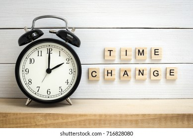 Daylight Saving Time Concept Represented with a Vintage Alarm Clock and Wooden Letters