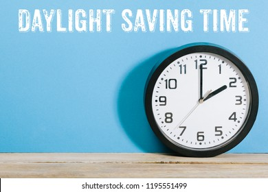 Daylight Saving Time written on wall behind clock turned to 2am