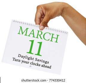 Daylight Savings March 11 Turn your clocks back calendar date held in hand white background
