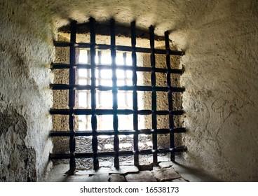 Daylight seen through iron prison bars