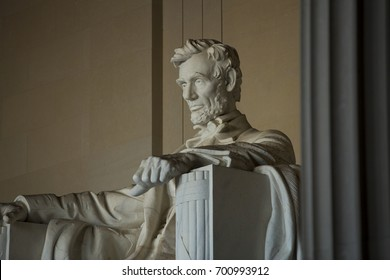 Daylight spills upon the statue of President Abraham Lincoln inside the Lincoln Memorial in Washington, DC.
