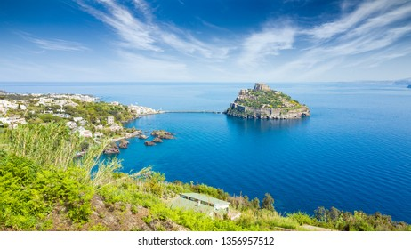 Daylight view of Gulf of Naples, Ischia Island and famous landmark and travel destination Aragonese Castle or Castello Aragonese, Italy.