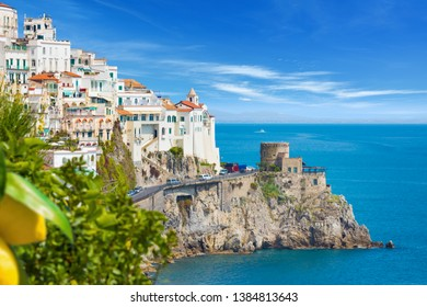 Daylight view of seaside city Amalfi in province of Salerno, Campania, Italy. Amalfi coast on Gulf of Salerno is popular travel and holyday destination in Europe. Ripe yellow lemons in foreground.