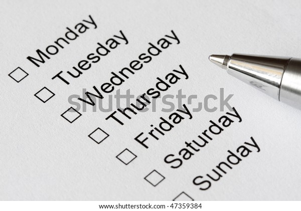 The days of week with checkboxes and pen to mark