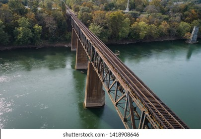 Daytime Aerial Landscape Photography Rusty Steel Long Bridge Train Track Crossing Historic Potomac River in Maryland, USA