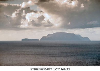 daytime clouds above rocky Madeira archipelago in Atlantic Ocean
