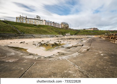 Daytime Long exposure of Tynemouth outdoor swimming pool in North Tyneside under renovation
