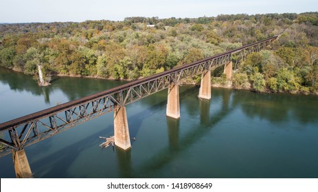 Daytime Scenic Aerial Drone Landscape Photograph Old Rusted Steel Railroad Train Trestle Crossing Historic Potomac River in Maryland, United States of America