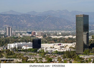 Daytime skyline view of the Burbank media center district, in California, looking past the 101 Ventura freeway.