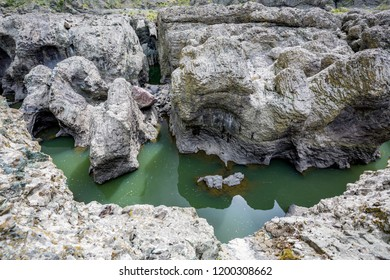 Daytime spring view taken at the amazing Devil's Canyon natural phenomenon in Bulgaria, also known as Sheytan Dere near Studen Kladenetz reservoir in Rhodope Mountain. Wonderful green waters