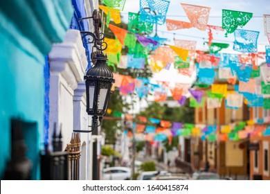 Daytime street scene of San José del Cabo's historic city center.