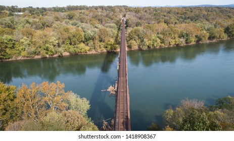 Daytime View Aerial Landscape Autumn Fall Photograph Rust Covered Old Vintage Antique Steel Railroad Train Trestle Track Crossing Historic Potomac River in Maryland, USA
